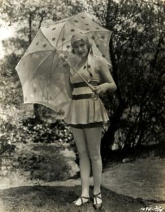 Esther Ralston with sheer polka dot umbrella
