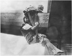 """21 June 1913: Georgia Ann (""""Tiny"""") Broadwick (1893–1979) was the first woman to jump from an airplane in flight with a parachute. She jumped from an airplane flown by Glenn L. Martin at 2,000 feet (607 meters) over Griffith Park, Los Angeles, California."""