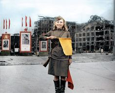 """""""Pvt Luba Rosanova - Berlin July 45 - Russian Zone"""" The building on the right is (was) the Department store 'Hermann Tietz' at Alexanderplatz in Berlin. Private Luba Rosanova was a """"Brown Haired, Blue Eyed 19 year old"""" ... she had met a French soldier (Henri Laure) in a German POW camp near Magdeburg where she was a prisoner for two years and they planned to be married."""