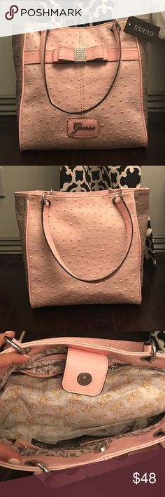 BRAND NEW Guess Ostrich Bag Brand new light pink and purple Guess ostrich bag. Very spacious on the inside. With tags. Guess Bags Shoulder Bags