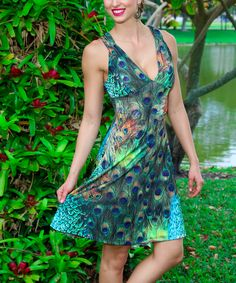 Green Peacock Cutout V-Neck Dress | zulily  . $19.99 Compare at $70.00 size: size chart S M L XL Product Description:  Flaunting a ladylike A-line profile, this dress features figure-skimming ruched detail and a flirtatious cutout that keeps your look on trend.      Size S: 39'' long from high point of shoulder to hem     95% polyester / 5% spandex     Hand wash; hang dry     Imported