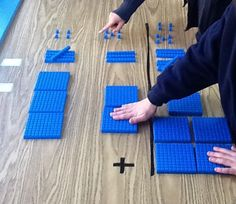 the concept of addition with larger numbers and regrouping to the concrete leve