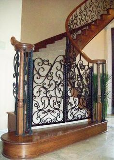 Iron Dog Gate-Evans Weaver - love this. We use iron baby gates to control where the dogs are but love the look of this on at the bottom of this staircase. Pet Gates For Stairs, Stair Gate, Staircase Gate, Stairway, Staircases, Wrought Iron Decor, Dog Rooms, Baby Gates, My Pool