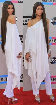 American Music Awards: Zendaya Coleman selected an all-white look from Donna Karan's Resort 2014 collection.  The 17-year-old actress and singer paired a one-shoulder tunic top and with white pants. She accessorized with John Hardy silver jewelry and completed the ensemble with a pair of Christian Louboutin heels.