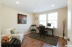 Kraft #home office. A little hideaway with dark office chairs, and a big comfy reading chair. The wood floors and dark rug exude class within this space.  #veronohomes #realestate #charm #decor http://www.verono.com/kraft/