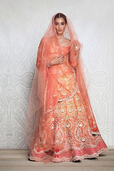 Tarun Tahiliani couture bridal lengha - not a fan of the draping, but damn do i love the peacock work on the lengha! Such a pretty color too <3