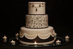 The wedding cake is simple yet romantic. The candles add warmth and intensity to the three-storey-cake. The details are quite sophisticated as well as the color.