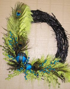 Feathered Wreath Funky Modern Door Wreath by TheJourneyAccents Peacock Wreath, Peacock Crafts, Feather Wreath, Peacock Decor, Feather Crafts, Peacock Feathers, Peacock Colors, Peacock Ornaments, Ostrich Feathers