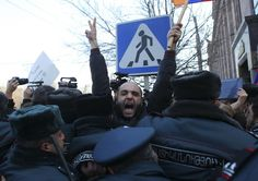 Policemen block protesters near the Russian embassy in Yerevan, Armenia January 15, 2015. Thousands of Armenians on January 14 and 15 rallied outside the Russian embassy in Yerevan and near the Russian military base in the town of Gyumri, demanding the handover of a Russian soldier suspected of killing a family. Valery Permyakov is said to have confessed to killing six members of Avetisyan family on January 12 after he took absence...