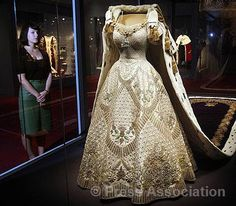 The Queen's Coronation Dress is displayed at Buckingham Palace as part of an exhibition to mark the 60th anniversary of the Coronation, 26 July 2013.