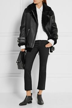 Black shearling Asymmetric zip fastening through front 100% shearling (Lamb) Specialist clean Imported