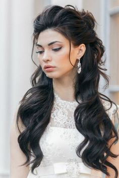 hairdos for long hair, long black wavy hair, large crystal hanging earrings, white lace dress