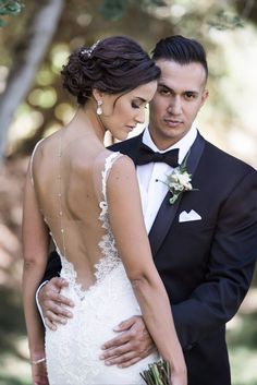 Gorgeous wedding photo! I like that the groom is the center of attention in this photo. Wedding photography | bride and groom | bridal gown