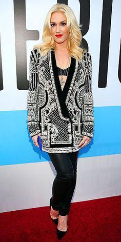 At the American Music Awards in LA last Sunday, singer Gwen Stefani rocked out in a beautiful, plunging black and white Balmain blazer paired with a matching bralette, skinny leather pants and Christian Louboutin pumps. She accessorized with Neil Lane diamonds and wore a stunning cross pendant that dangled in just the right place. Her hair fell in soft waves and a pop of red lipstick completed her ensemble.