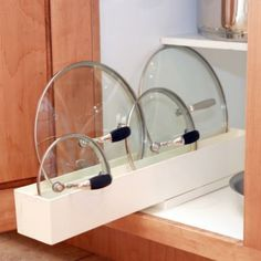 Lid Maid Lid Organizer - BedBathandBeyond.com - for pots and pans cabinet. Get 2, 1 for tupperware lids.