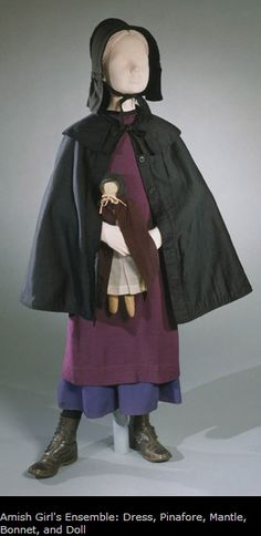 Philadelphia Museum Amish Girl's Ensemble: Dress, Pinafore, Mantle, Bonnet, and Doll Made in Arthur, Illinois, United States, North and Central America 1900-1920 Artist/maker unknown, American, Amish. From the family of Mrs. Ida S. Beachy, American (Arthur Illinois). Cotton, wool, and rayon Currently not on view 1995-128-6,8,29;1996-149-6a--h Purchased with the Costume and Textiles Revolving Fund, 1995