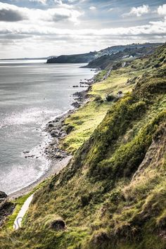 The causeway coastal route in Northern Ireland is a beautiful part of this country and extra fun if you're a game of thrones fan Places In Europe, Places To Visit, Fantasy Art Landscapes, Emerald Isle, Holiday Wishes, Toronto Canada, Belfast, Coastal, Beautiful Places