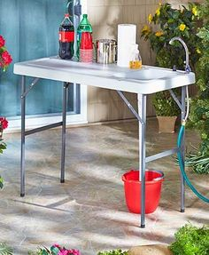 This Portable Sink Table is just what avid outdoor lovers need. The double-wall tabletop is perfect for cleaning fish, processing game and washing up while camping. It's also a handy surface for potting plants, rinsing off veggies or tailgating. The larg