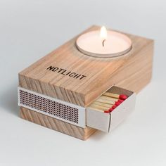 Adorably useful small wooden candle. Combining a space exactly of the size of the most common match box it shows a very intuitive way of using it. Tell me you don't want one and I will not believe you.