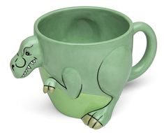 T-Rex Mug. Just like we imagine of the real T. rex , this guy has stubby little arms sticking out the front and a convenient handle on the back.
