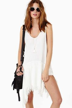 white tattered looking dress.