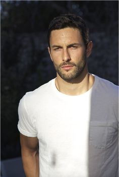 A brooding Noah Mills...still ridiculously hot More