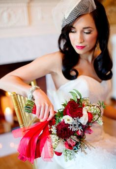 Red bouquets are also a great idea & go well with a white wedding dress!