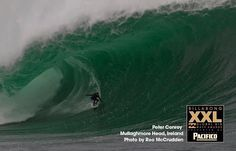Peter Conroy rides a monster wave at Mullaghmore January, 2013. Peter is nominated for Billabong XXL award. Surfer from Lahinch sponsored by Emerald.
