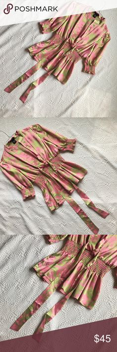 """BCBGMaxAzria Women Shirt Medium $119 Pink Green BCBG Maz Azria Women Shirt Medium $119 Pink Green Floral Deep V Neck Pussy Bow Blouse Great Condition Silky Fabric 3/4 Sleeve Originally $119!!! Measurements: Length 24.5""""Shoulders 15"""" Sleeve Length 15"""" Armpit to Armpit 8.5"""" Waist Flat(Elastic Stretch to the waist) 12"""" . Fabric: 98% Polyester 2% Spandex BCBGMaxAzria Tops Blouses"""