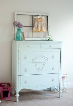 """painted the walls Benjamin Moore's """"Irish Mist"""", a very light (almost white) gray. The room is filled with a mixture of antique finds and things I've made or transformed in some way .I found the dresser and vanity on Craigslist and then gave them both a new look by painting them with Benjamin Moore's """"Whispering Spring"""" and then distressing them."""