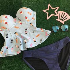 Ice Cream Peplum top $55.50 Navy Bikini bottoms $26.50 www.kingdomandstate.com   #swim #swimwear #swimtop #swimbottom #retro #retroswim
