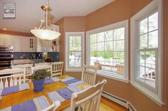 Beautiful, large windows we installed in this superb dinette and eat-in kitchen in Suffolk County...