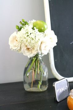 Like the vase and simplicity of this arrangement