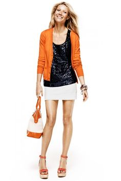 Gwyneth Paltrow in Black sequined tank and White mini skirt  with orange cardigan. Lindex campaign.