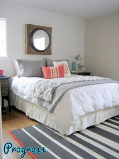 Gray and coral bedroom with teal accents. I love these colors together! Love the throw pillows on the bed! :)