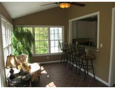 Kitchen with bar opening into sunroom