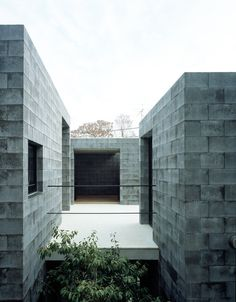 a composition of three monolithic volumes constructed out of more than 7000 concrete blocks, the design inwardly opens up to an elevated outdoor terrace.