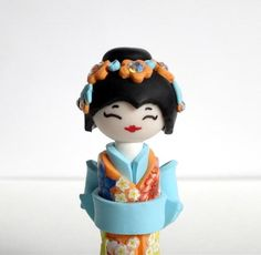 Miniature Japanese Doll , Kokeshi Doll, Pastel's Orange Turquoise ,Shabby Chic, Unique Handmade Sculpture doll. $40.00, via Etsy.