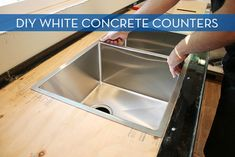 These white concrete beauties are at the top of my countertop wishlist! via Chris Loves Julia