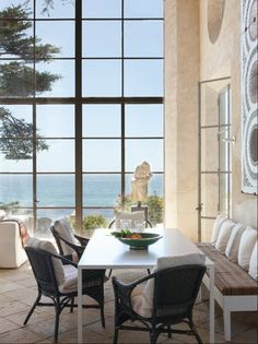Huge Window, banquette seating, tile floors and wicker dining in this Ocean Home Beautiful Interiors, Beautiful Homes, Porches, South Shore Decorating, Huge Windows, Tall Windows, Interior Decorating, Interior Design, Modern Interior