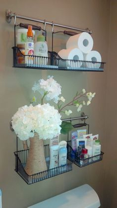 It doesn't take up any valuable floor space or require shelf installation, which makes it super easy to use. If you already have towel rods installed here, you could just buy the baskets! From here.