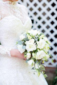 Breathtaking Wedding Bouquet Recipe: White Lisianthus and eucalyptus bouquet. Click to blog for more gorgeous bouquet ideas.