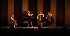 Members Of A Classical Quartet Try To Outplay One Another During Their Performance.