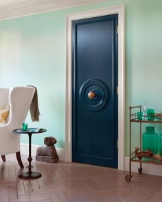 Uses plastic medallions from the hardware store, painted and applied to a door, they look downright sculptural.