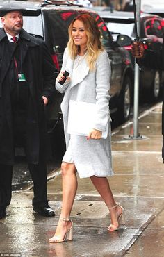 Simply chic on the street: Conrad wore a grey coat and beige heels...