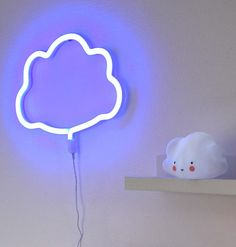 How sweet is this blue cloud shaped neon style light? Our energy efficient durable LED version of the popular retro neon light is made from plastic and thus is ideal for decorating a children's room. It also has built-in hooks for easy hanging, an on/off Blue Neon Lights, Neon Light Signs, Neon Signs, Light Blue, Yellow Cloud, Blue Clouds, Kids Lighting, Neon Lighting, Lightning Cloud