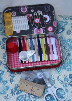 altoids sewing kit  with band aids, nail clippers and nail file, saftey pins bobby pins, more of an emergency kit