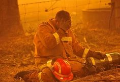 Exhausted Firefighter on Black Saturday at Bunyip State Park in Victoria, Australia Firefighter Paramedic, Firefighter Quotes, Volunteer Firefighter, Fire Dept, Fire Department, Black Saturday, Emergency Responder, Wild Fire, God Bless America