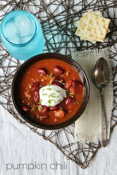 This Slow Cooker Pumpkin Chili recipe is healthy and easy for busy weeknights. Try mixing up a batch of this in your crock pot- it is the perfect fall chili dish!