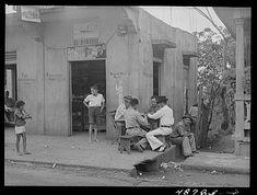 Jugando Domino,en un esquina de Bayamon,año 1941,Puerto Rico.
